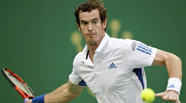 The eyes have it as Andy Murray returns the ball on his way to beating Roger Federer in the final of the Shanghai Masters. Photo: AP