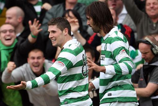 Gary Hooper is congratulated by Georgios Samaros after scoring the winning goal for Celtic at Tannadice yesterday. Photo: PA
