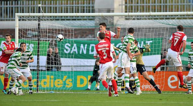 Paddy Kavanagh (left) heads the ball into his own net to deny Shamrock Rovers victory at Tallaght Stadium yesterday. Photo: David Maher / Sportsfile
