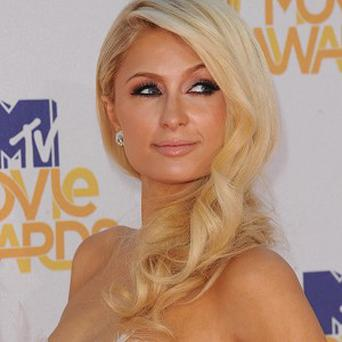 Paris Hilton has settled a lawsuit over the promotion of her movie flop Pledge This!