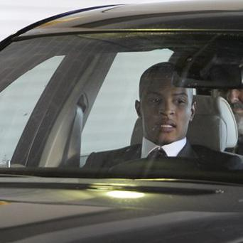 Rapper T.I. leaves Federal Court after being sentenced to 11 months in prison for a probation violation (AP)