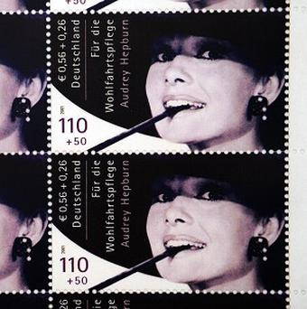 A repro of a set of Audrey Hepburn stamps was sold at auction (AP)