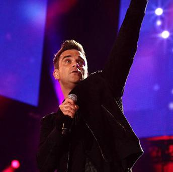 Robbie Williams has seen his new album go straight to the top of the charts