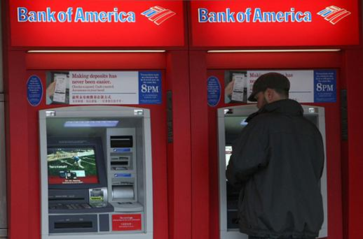 Bank of America took a goodwill charge of $10.4bn because laws enacted this year could slash as much as 80pc of debit-card revenue. Photo: Getty Images