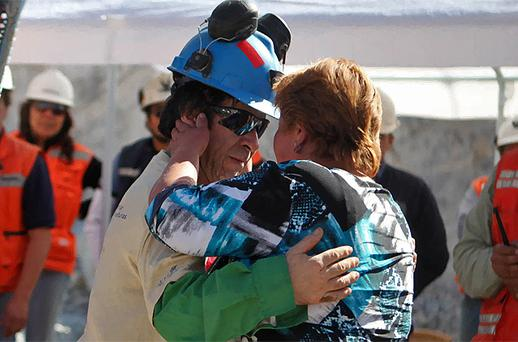 Yonni Barrios Rojas is met by Susana Valenzuela after he is rescued from the mine. Photo: Reuters