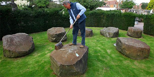 James Reynolds, Director of Summers Place Auctions in Billingshurst, West Sussex, prepares one of seven stones believed to be from the Giants Causeway for sale. Photo: PA