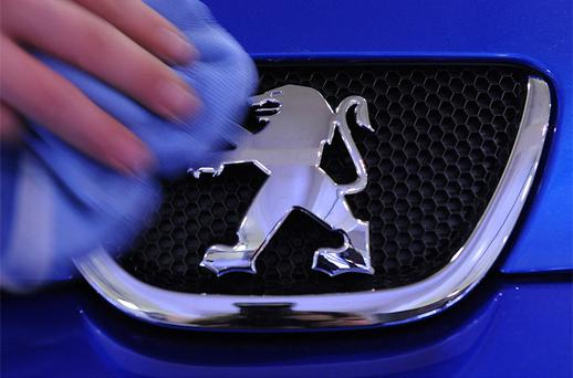 Peugeot climbed 0.9pc as the carmaker said quarterly revenue grew and raised its full-year outlook. Photo: Bloomberg News