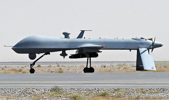 A US Predator unmanned drone armed with a missile stands on the tarmac of Kandahar military airport. Photo: Getty Images