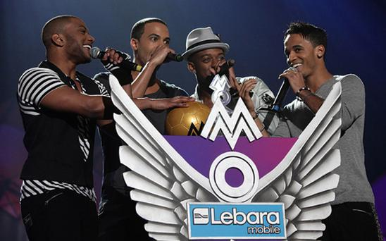 Members of JLS on stage during the 2010 Mobo Awards, at the Echo Arena, Liverpool. Photo: PA