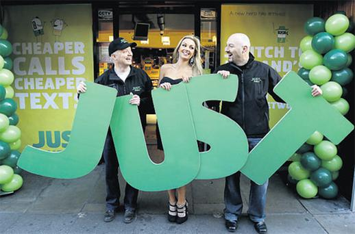 On the line: Model Rosanna Davison, with Stuart Kelly (left) and Donal Lawless, cofounders of Just Mobile, at the launch of the only Irish-owned independent mobile network provider