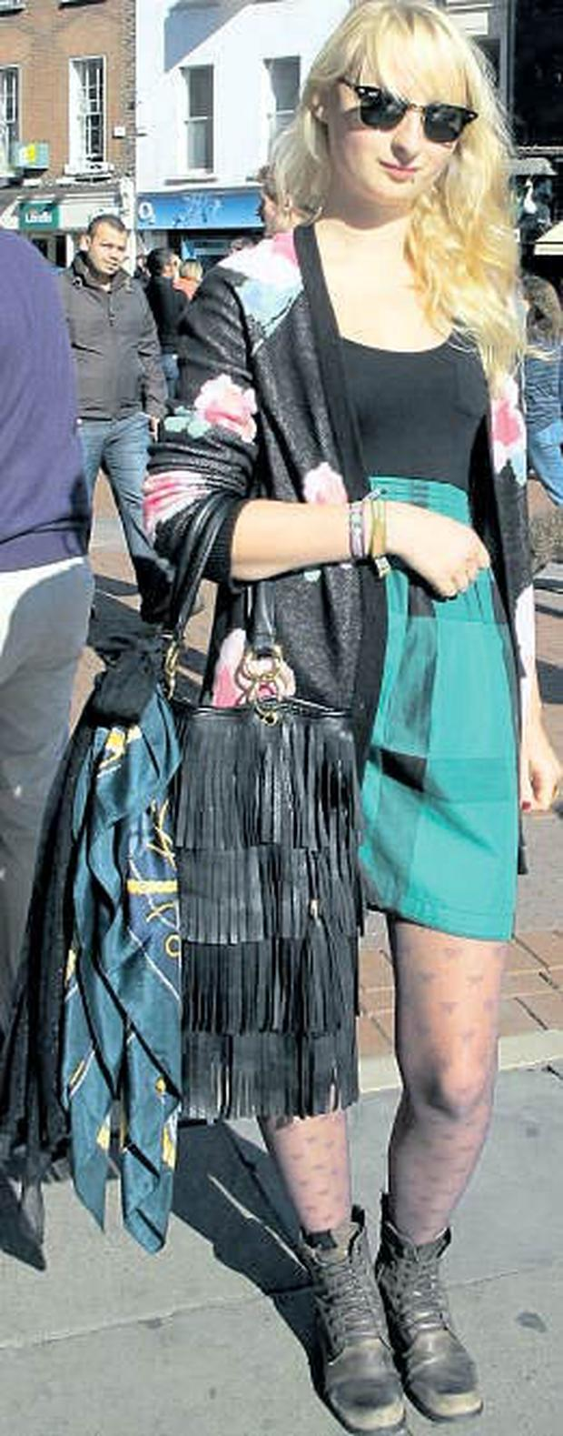 Magda Pietrykowska, wearing: Cardigan, €40, and dress, €70, both from Topshop. Bag, €10, alwear. Scarf, €3, a charity shop in Amsterdam. Sunglasses, €150, www.ray-ban.com. Tights, €3, Penneys. Boots, €50, River Island.