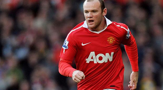 Wayne Rooney has signed a new five year contract with Manchester United. Photo: PA