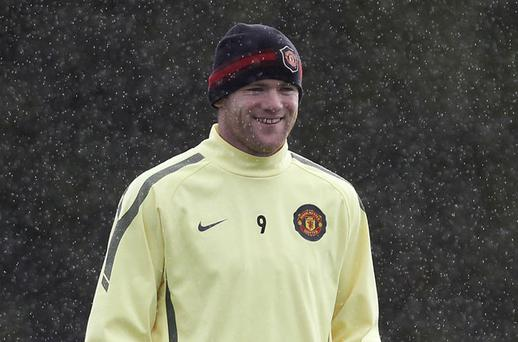 Manchester United striker Wayne Rooney has plenty to smile about after signing a new five-year contract. Photo: Reuters