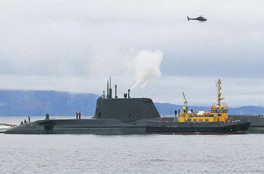 Crew members stand on the deck of the nuclear-powered submarine HMS Astute yesterday, near the Skye bridge off the Isle of Skye in northwest Scotland