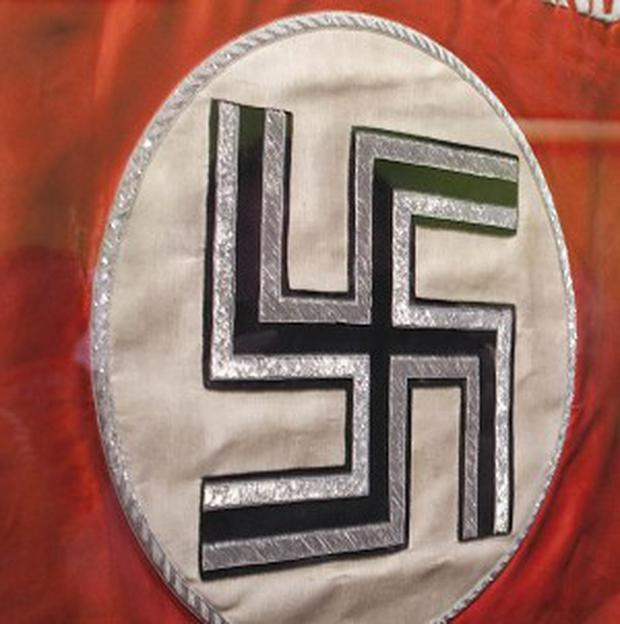 The leader of a borough council defended his decision to go to a fancy dress party dressed as Adolf Hitler