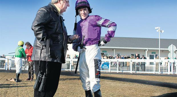 Harry Findlay in coversation with Tony McCoy before a race at Ffos Las earlier this year. Photo: David Conachy