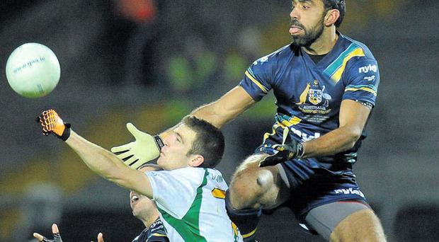 Australia's Adam Goodes jumps highest against Brendan Donaghy of Ireland during last night's International Rules Test at the Gaelic Grounds in Limerick. Photo: Alan Place