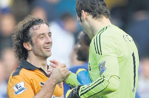 Stephen Hunt shakes hands with Chelsea goalkeeper Petr Cech after the final whistle at Stamford Bridge yesterday. Hunt was involved in a collision with the Cech resulting in a fractured skull for the Chelsea goalkeeper four years ago. Photo: Nick Potts