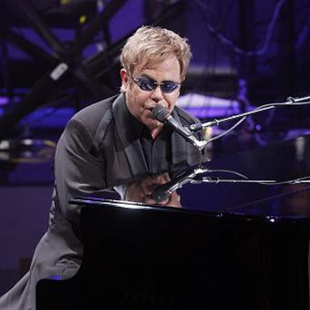 Sir Elton John says his dinner was once spiked with cocaine