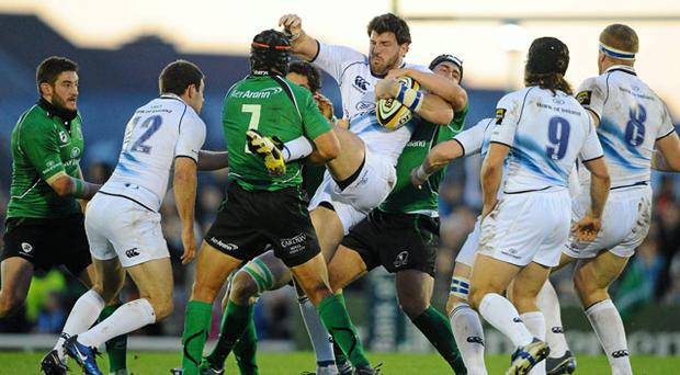 Leinster's Shane Horgan is tackled by Ian Keatley and Ray Ofisa, 7, of Connacht during their Magners League game on Saturday STEPHEN MCCARTHY / SPORTSFILE