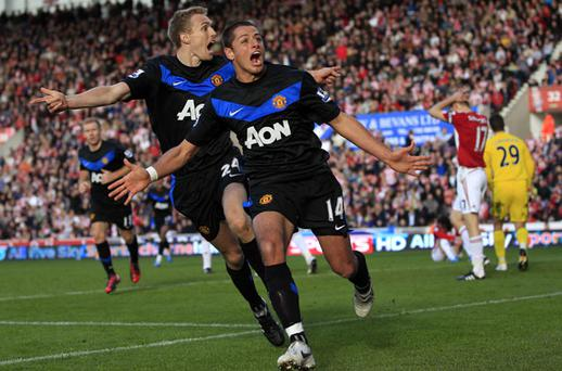 Manchester United match-winner Javier Hernandez celebrates his winning goal alongside team-mate Darren Fletcher at Stoke yesterday. Photo: Reuters