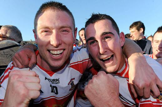 Paidi Nevin (left) and Stephen Daniels celebrate De La Salle's victory over Ballygunnar in the Waterford SHC final at Walsh Park. MATT BROWNE / SPORTSFILE