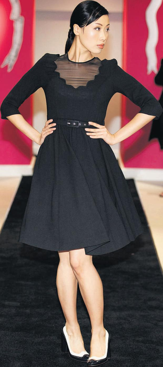 Crepe dress with scalloped neckline, €295, Peter O'Brien