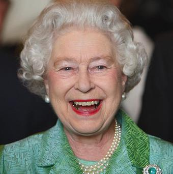 The Queen is the ultimate middle-class hero, according to a new handbook