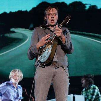 Arcade Fire performing on the Main Stage at the Reading Festival. The band is up for a Q Award