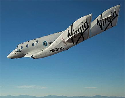 The Virgin Galactic SpaceShipTwo glides toward the earth on its first test flight after release from the mothership. Photo: Reuters