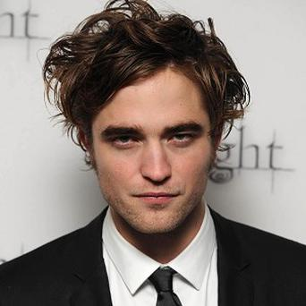 Robert Pattinson says he doesn't think his music is mainstream enough for Simon Cowell
