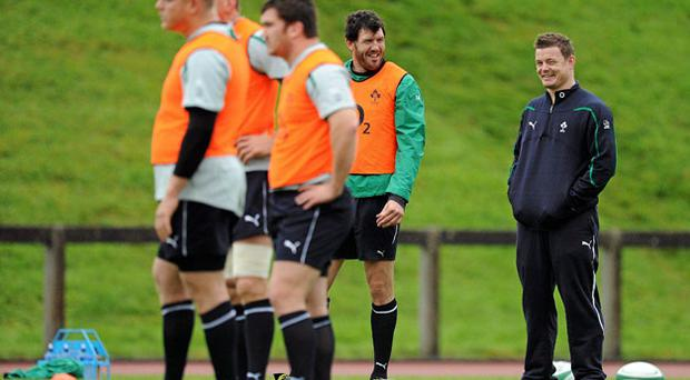 Brian O'Driscoll (R) can only watch after injury forced the Irish captain out of yesterday's training session in Limerick. Photo: Brendan Moran / Sportsfile