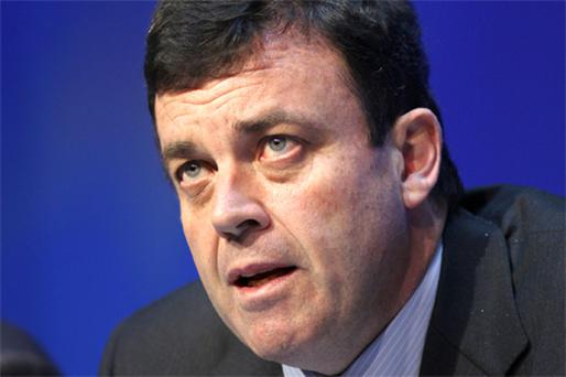 Finance Minister Brian Lenihan will next month announce details of the budget plan, which he said will include a 'significant frontloading' for 2011. Photo: Bloomberg News