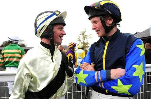 Jockey/trainer Denis Hogan (left), who was riding Regal Ambition for Charlie Swan, gives some last-minute advice to Eddie Power, who was riding Drive On Jim, which is trained by Hogan, before the Dobbins Beginners Chase at Punchestown. Both horses fell.
