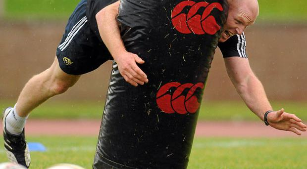 Paul O'Connell gives a tackle bag the full treatment during Munster squad training ahead of tomorrow night's game against Ulster. Photo: Diarmuid Greene / Sportsfile