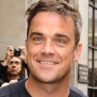 Robbie Williams has admitted to installing cameras in his bedroom for an online show, then forgetting they were there