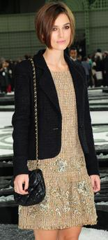 Keira Knightley opted for a small padded Chanel bag at Paris Fashion Week. Photo: Getty Images