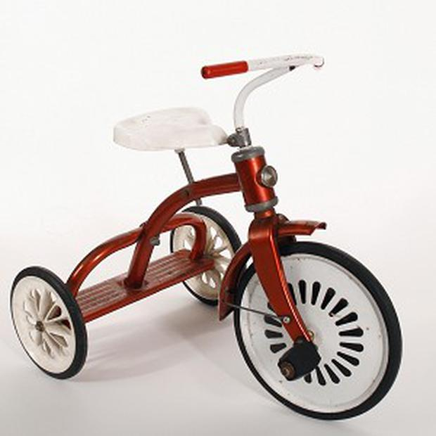 The blood-red tricycle ridden by demonic child Damien in horror film The Omen is being auctioned