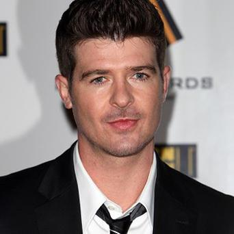 Robin Thicke says fatherhood is a bit scary