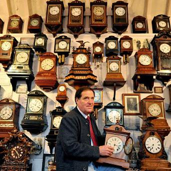 Roman Piekarski makes a start changing the time on the 600 cuckoo clocks at his museum