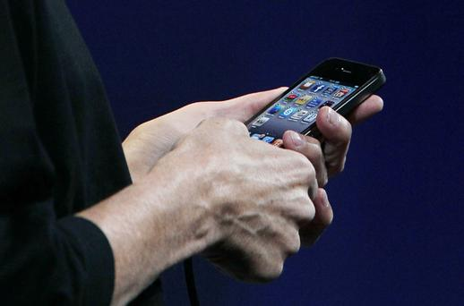 Apple shipped 14.1 million handsets during the most recent financial quarter. Photo: Getty Images