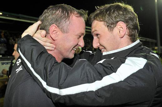 Shamrock Rovers manager Michael O'Neill celebrates with Gary Twigg after the Hoops clinched the Premier League title at the Carlisle Grounds last night. DAVID MAHER/SPORTSFILE