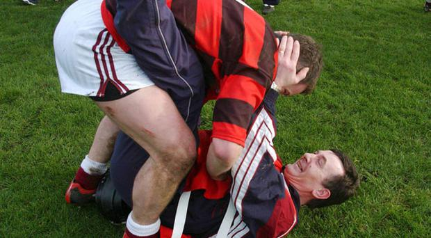 Clarinbridge captain of 2001 Michael Donoghue celebrates with then manager Billy McGrath. Tomorrow as manager, Donoghue will be hoping to re-capture the Galway SHC title. Photo: Sportsfile