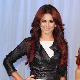 X Factor judge Cheryl Cole is on track to hit number one this week, despite miming on her TV talent show