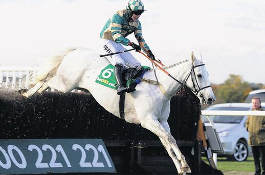 Nacarat and Sam Thomas on their way to victory in the bet 365 Charlie Hall Steeplechase at Wetherby yesterday