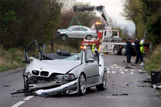The BMW in which two men died after colliding with a Toyota Avensis at Carr's Hill, Carrigaline, Co Cork