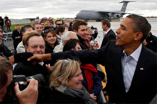 US President Barack Obama shakes hands with well-wishers after arriving in Cleveland to attend a DNC Moving America Forward Rally at Cleveland State University in Ohio yesterday