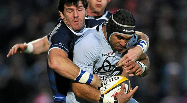 Edinburgh's Netani Talei is tackled by Shane Horgan of Leinster during their Magners League clash on Saturday. Photo: Paul Mohan / Sportsfile