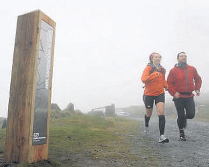 Susie Mitchell and Cormac McDonnell running along the Dublin Mountains Way yesterday
