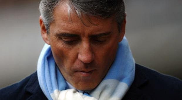 Manchester City manager Roberto Mancini is once again in the firing line after consecutive Premier League defeats. Photo: Getty Images
